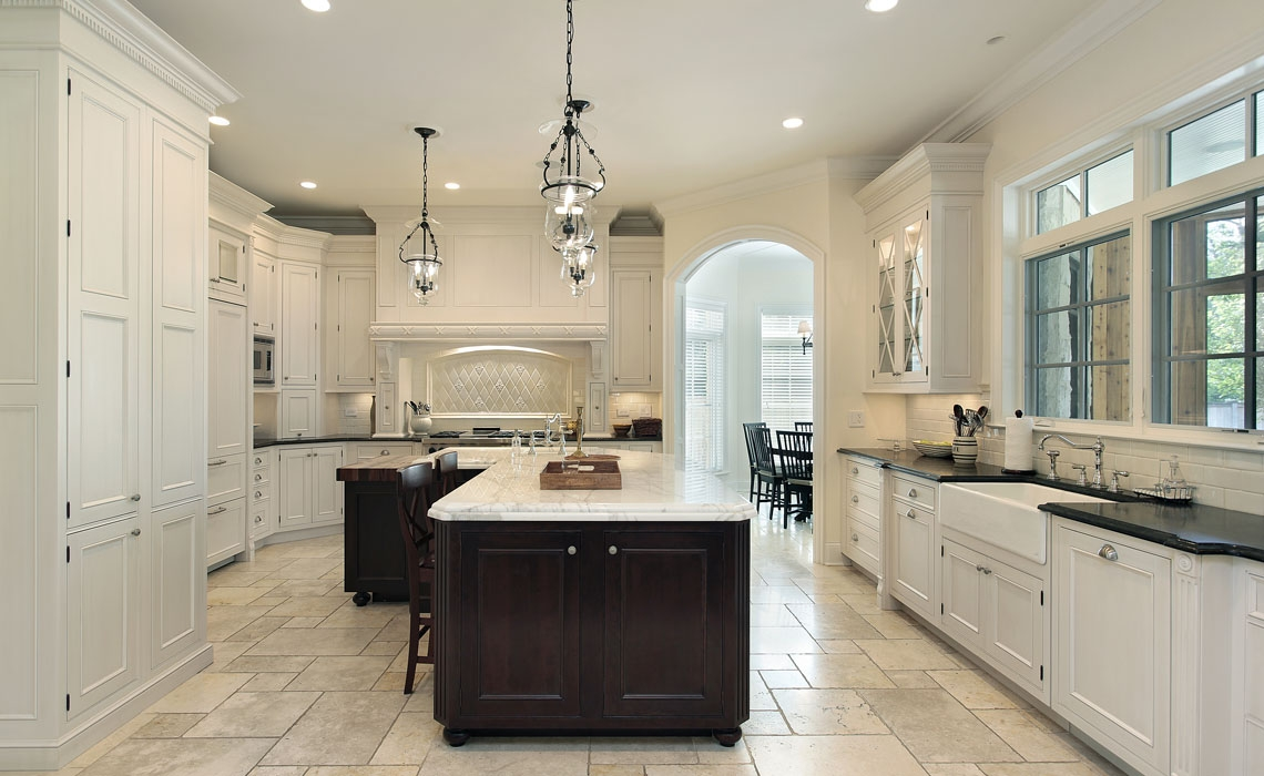 Luxury kitchen in suburban home with white cabinetry
